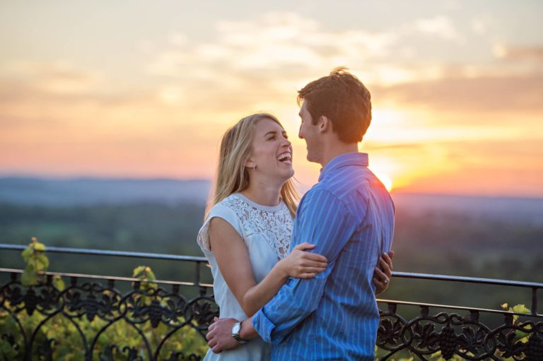 A couple embraces at their sunset engagement session at Gouveia Vineyard in Wallingford CT
