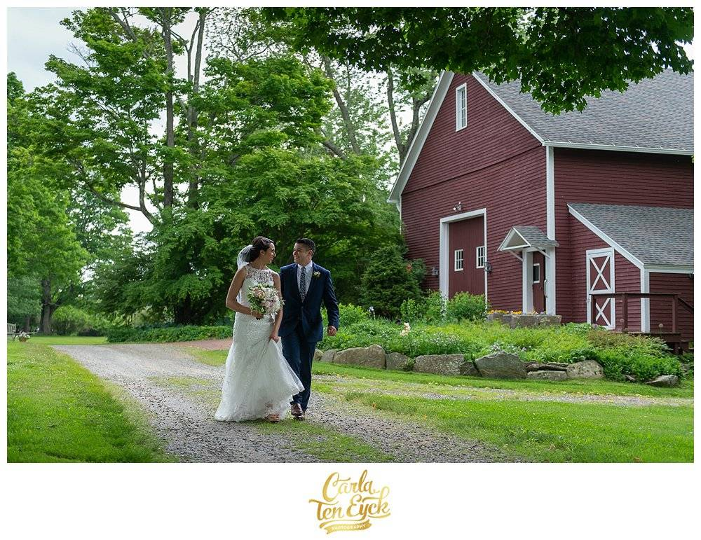 Bride and Groom walking at their wedding at Tyrone Farm in Pomfret CT