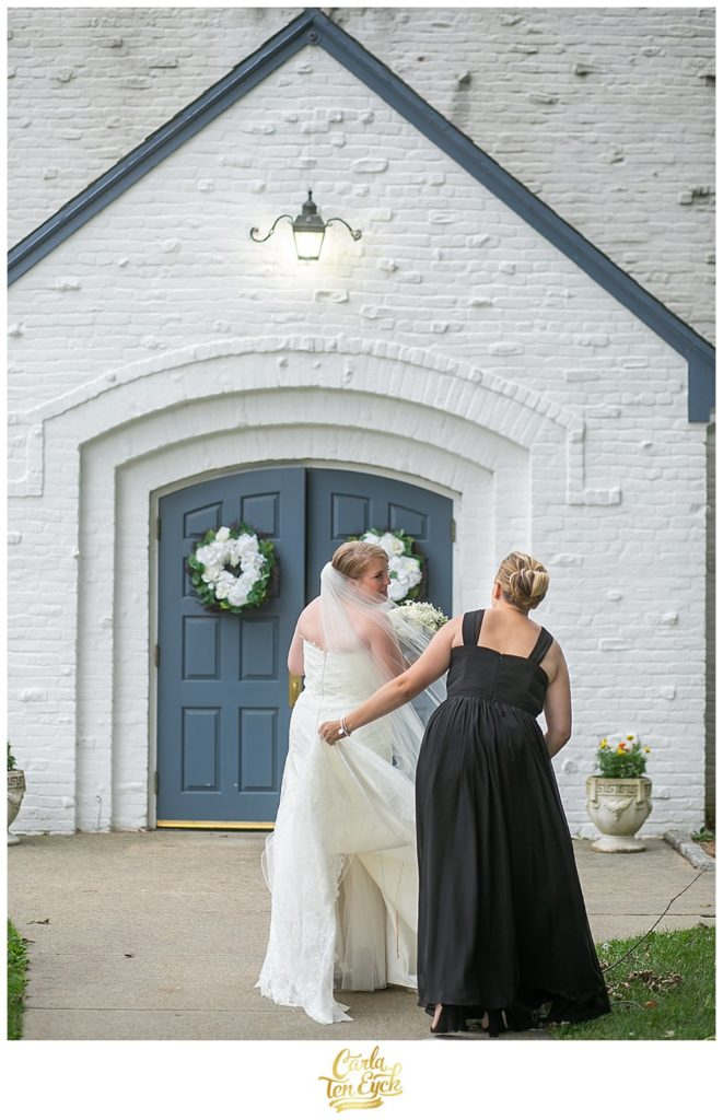 Bride enters the church with her bridesmaid on her wedding day in Lordship CT