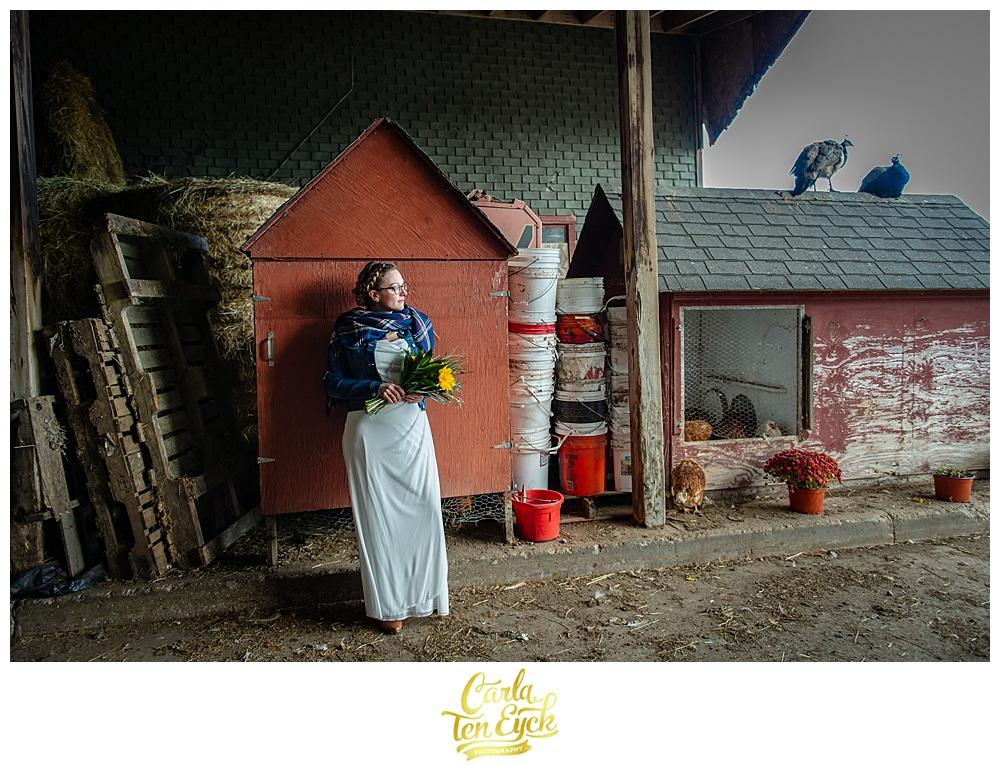 Bride stands in a barn on their wedding at Cold Spring Farm in Colchester CT