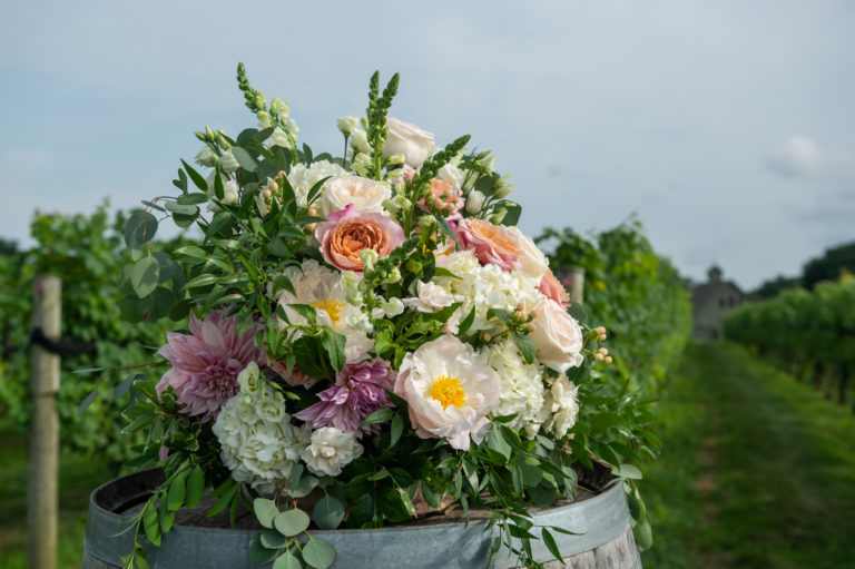 Wedding flowers by Hana Floral at Jonathan Edwards Winery