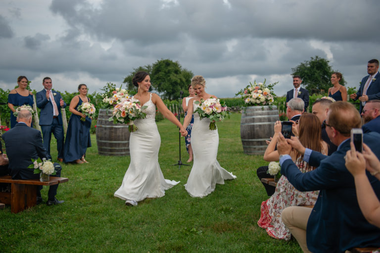 Two brides at their wedding ceremony at Jonathan Edwards Winery in North Stonington CT
