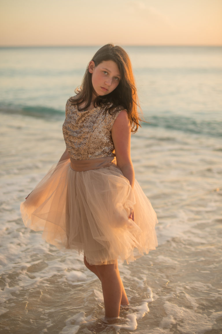 Girl in champagne dress on Seven Mile Beach Grand Cayman