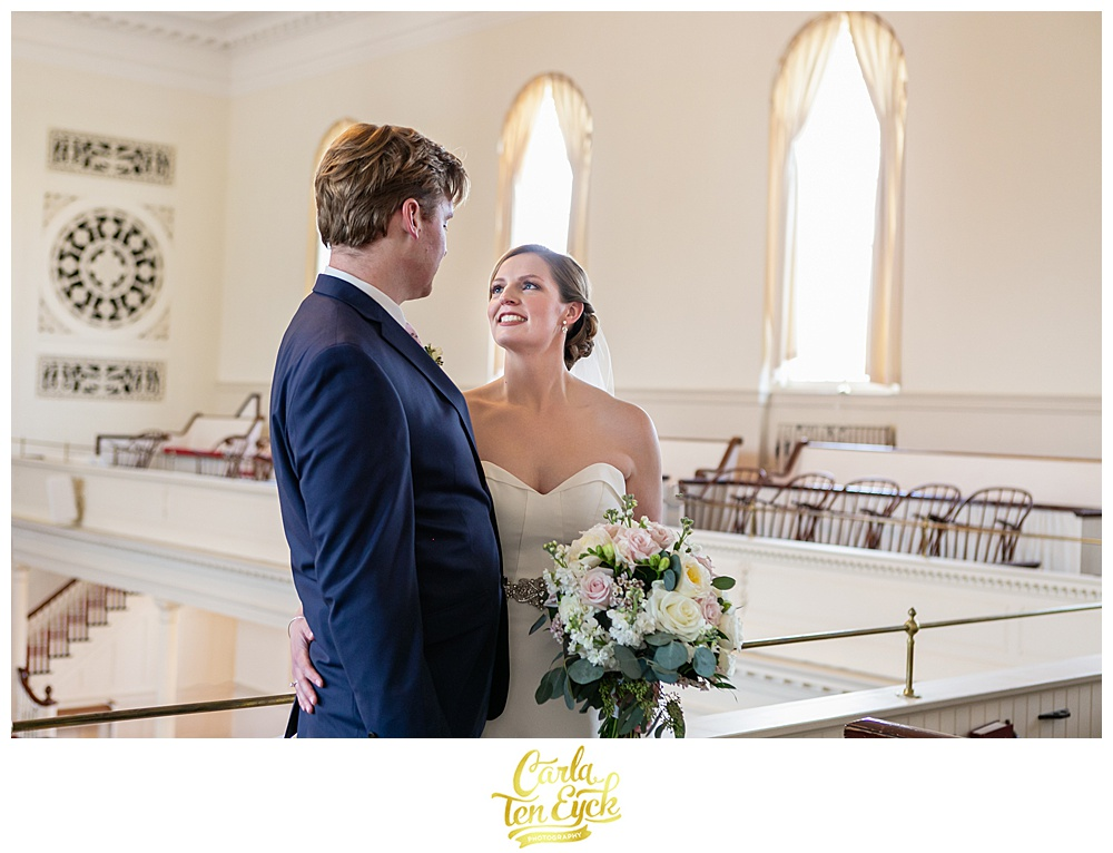 Bride smiles at her groom after their wedding at First Congregational church in Danbury CT