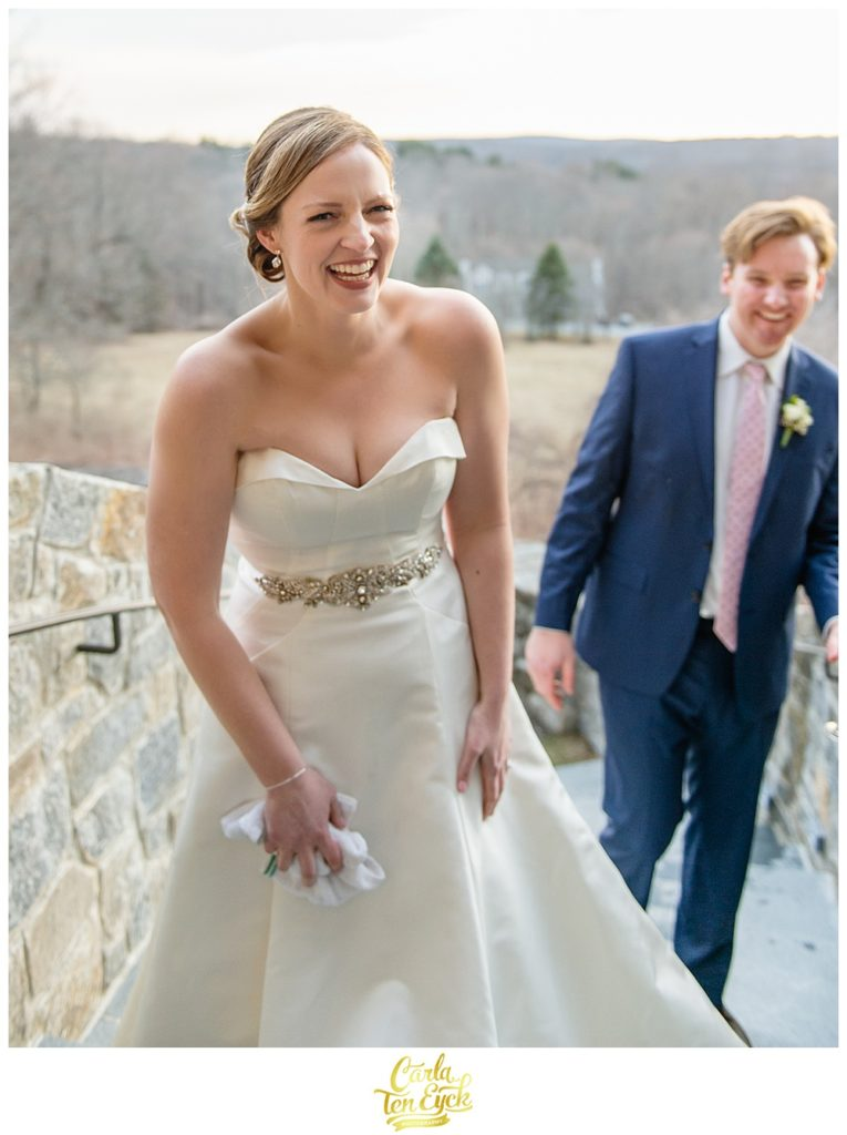 Bride laughs in her Antonio Gaul wedding gown at her wedding at Le Chateau in South Salem NY