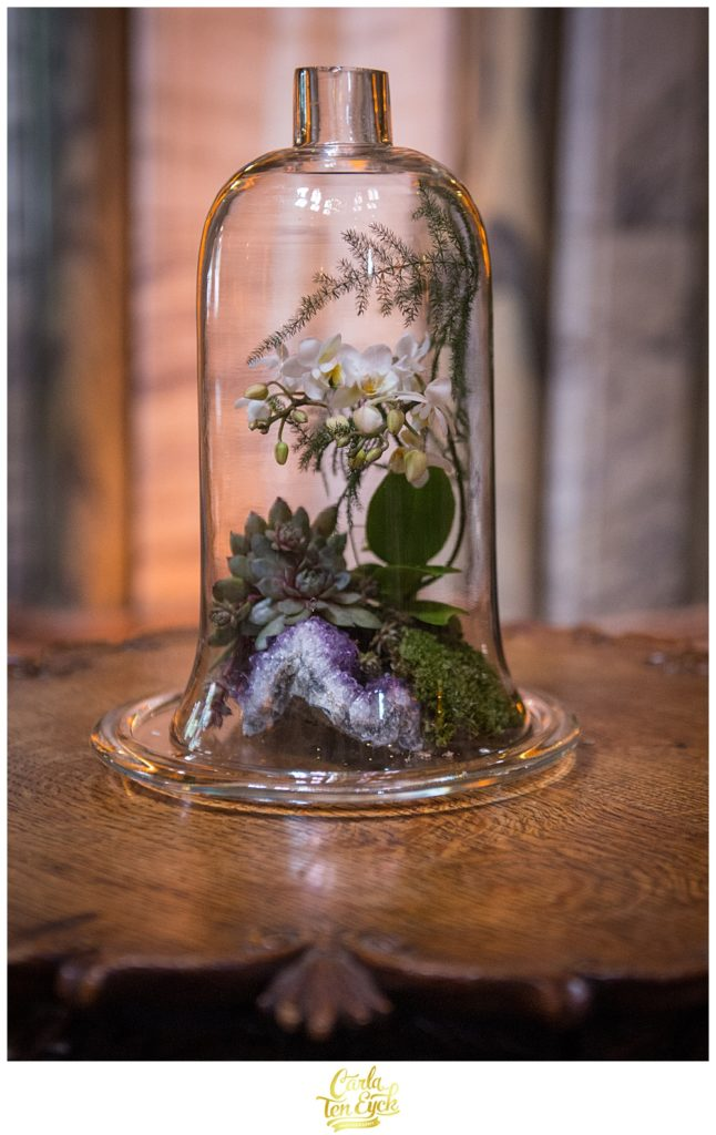 Bell jar with terrarium amethyst geode and white orchids
