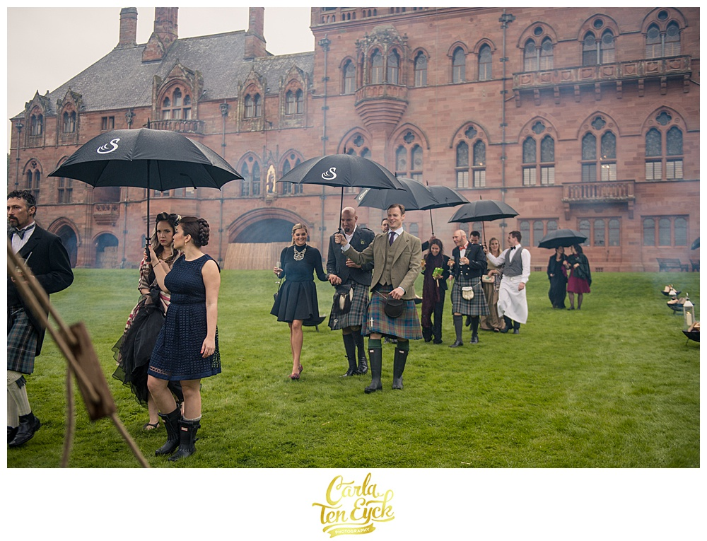 Guests arrive at a rainy wedding at Mount Stuart on the Isle of Bute Scotland