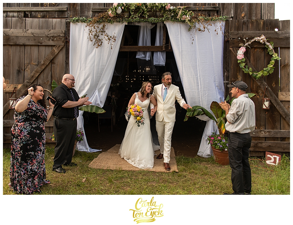 Happy bride and groom just married at their tobacco barn backyard wedding in CT