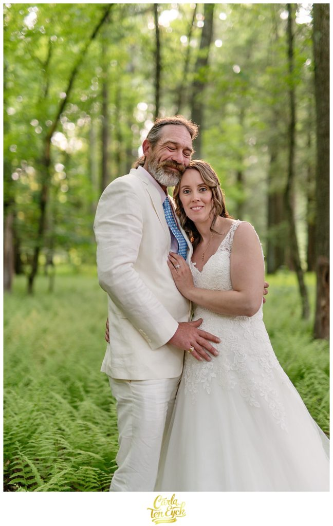 Bride and groom in a fern grove after their backyard CT wedding