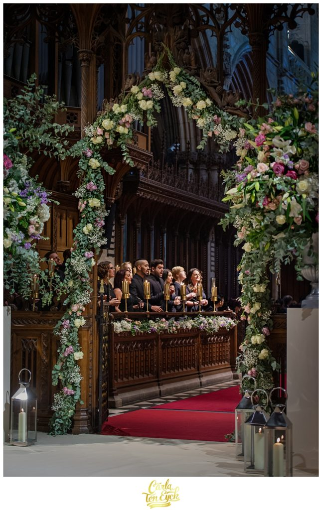 A choir sings at a wedding ceremony at Selby Abbey Yorkshire UK