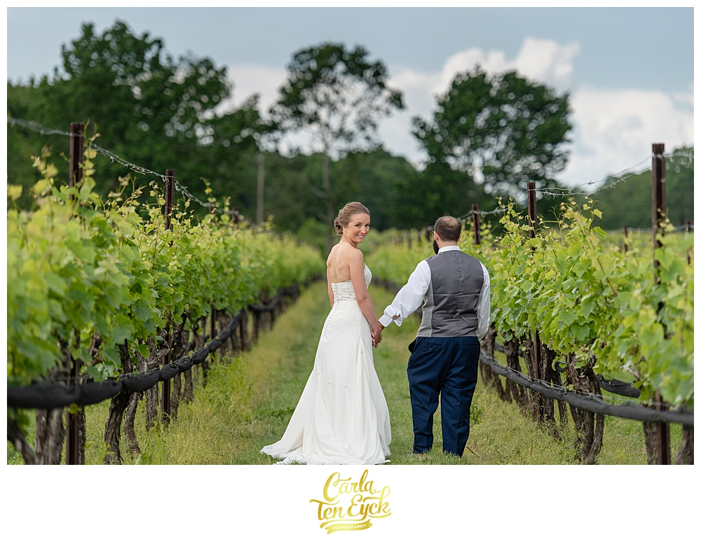 Bride and groom in the vineyard at Jonathan Edwards winery wedding in North Stonington CT