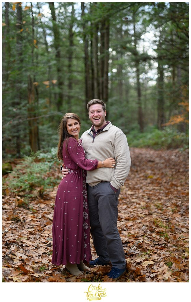 Couple snuggles in the woods at Valley View farms in Haydenville MA