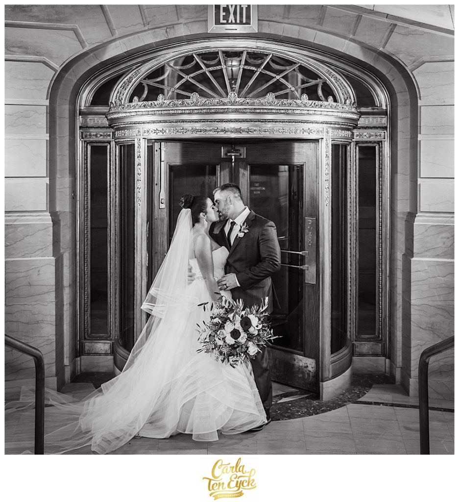 A bride and groom kiss at Hartford City Hall Hartford CT