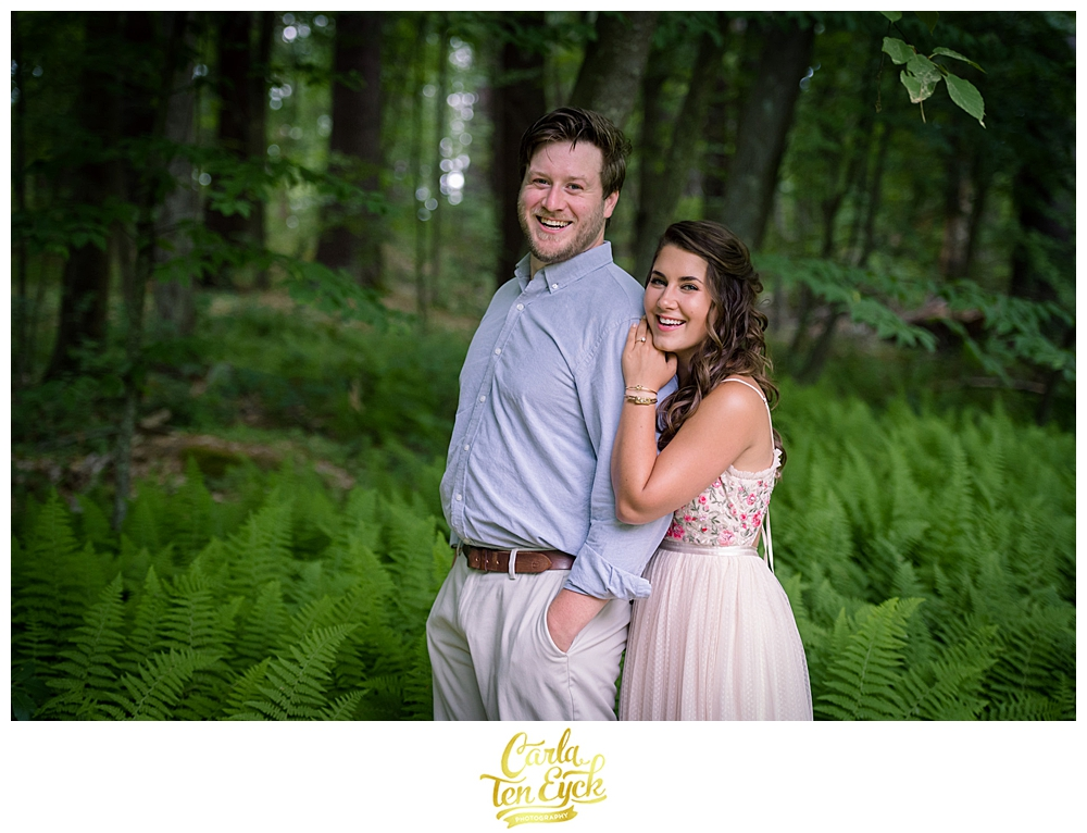 Couple poses for photos during their rustic micro wedding