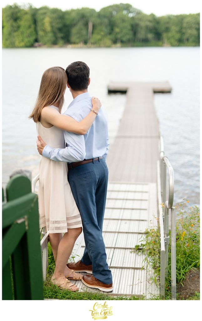 Couple embraces on Lake Waramaug in New Preston CT during their engagement session