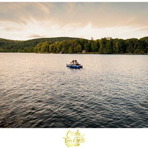 A couple kayaks during their engagement session on Lake Waramaug New Preston CT