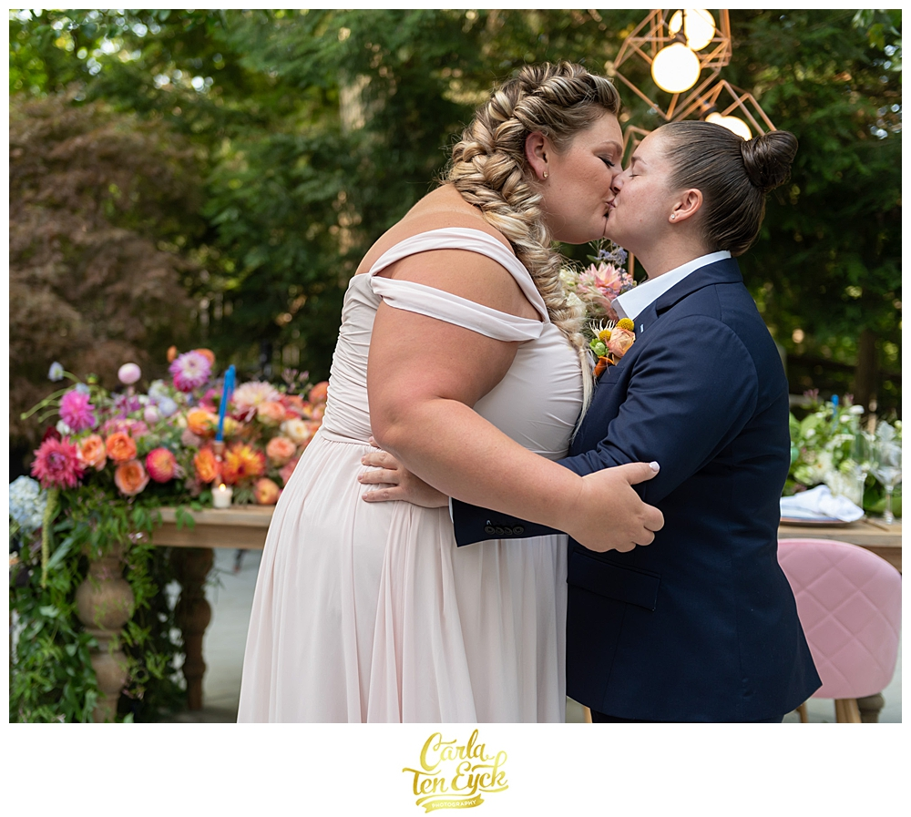 Two brides kiss at their LGBTQ Wedding with Amy Champagne Events