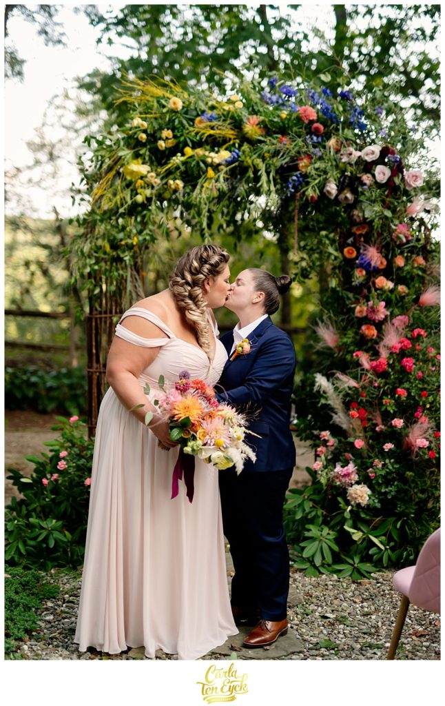 Two brides kiss at their intimate LGBTQ wedding in Weston CT