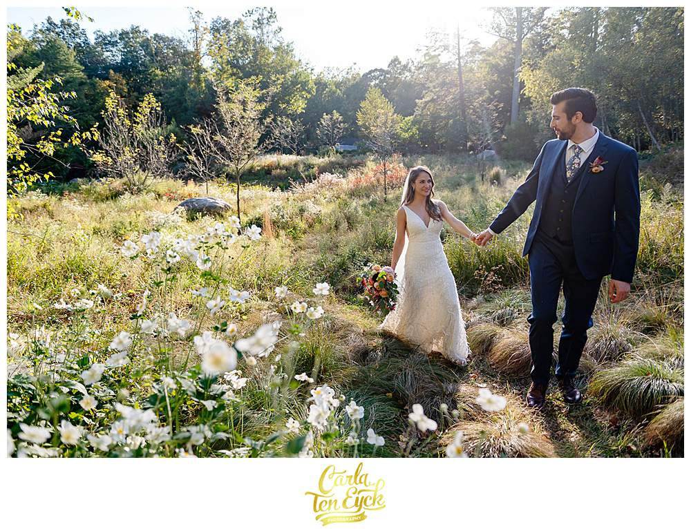A bride and groom smile in a field during their intimate wedding at The Chatfield Hollow Inn in Killingworth CT