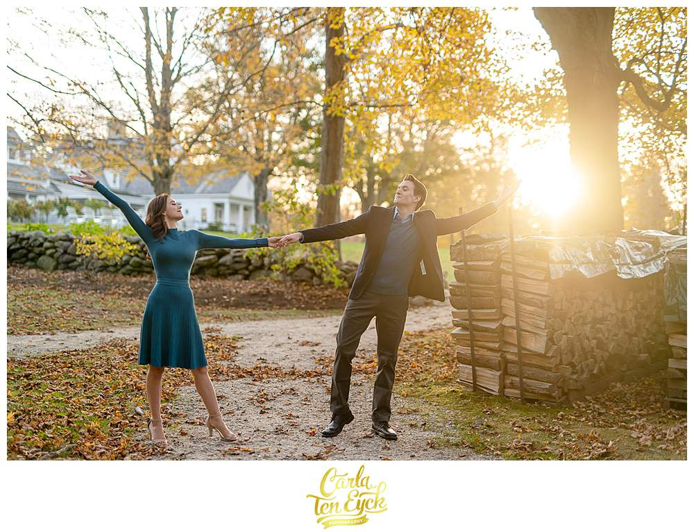 A couple dances during their engagement session at Smith Farm Gardens in East Haddam CT
