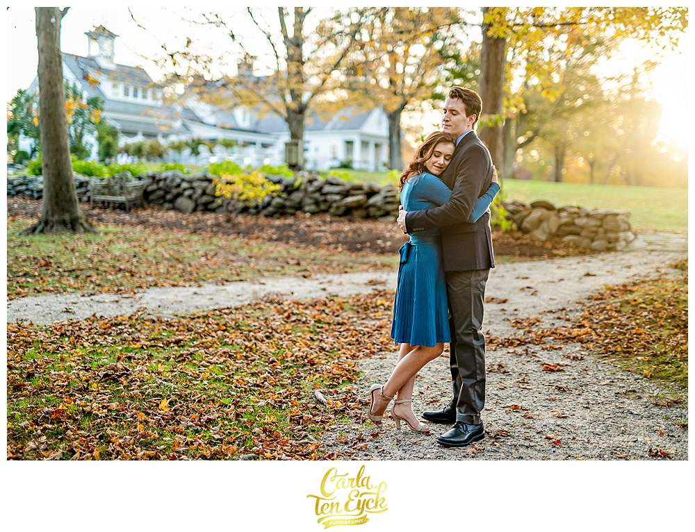 A couple hugs during their engagement session at Smith Farm Gardens in East Haddam CT during golden hour