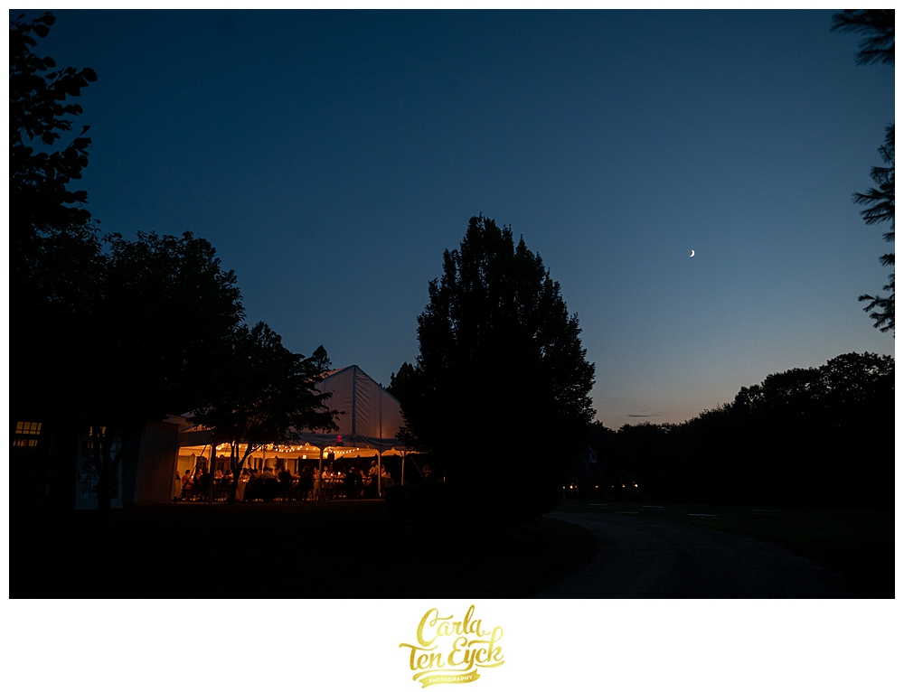 A tent glows at night at a Winvian wedding in Morris CT