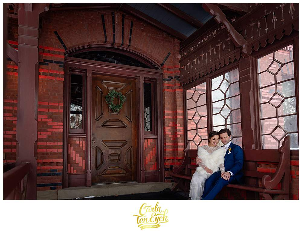 A couple embraces on the porch on their wedding day at The Mark Twain House in Hartford CT