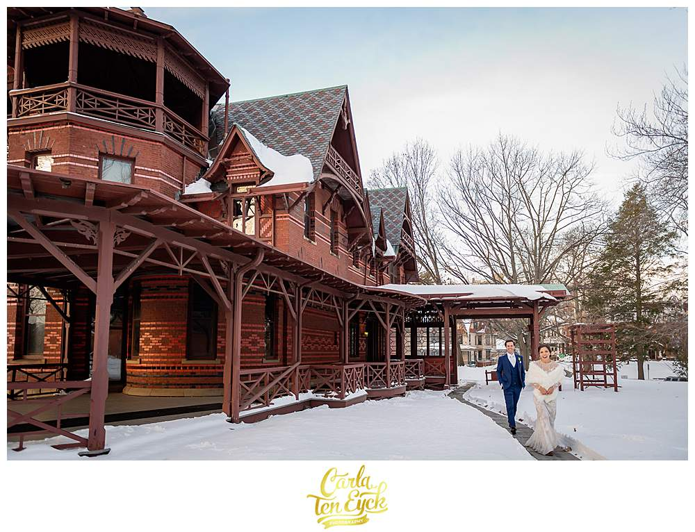 A bride and groom on their winter wedding day at the Mark Twain House in Hartford CT