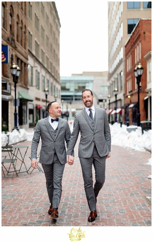Two grooms take wedding photos on Pratt Street in Hartford CT on their wedding day