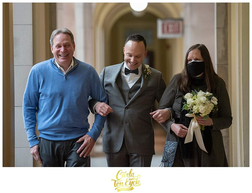 A groom walks down the aisle during his Hartford City Hall elopement in Hartford CT