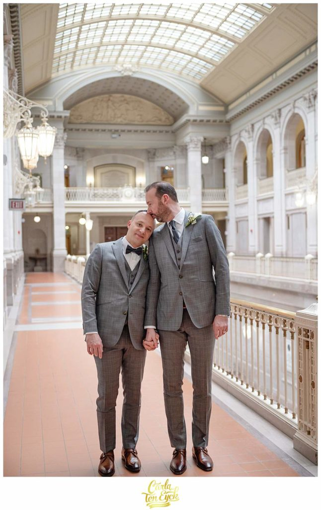 Two grooms kiss at Hartford City Hall at their elopement in Hartford CT