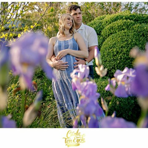 A couple snuggles during their maternity session at Harkness Park in Waterford CT