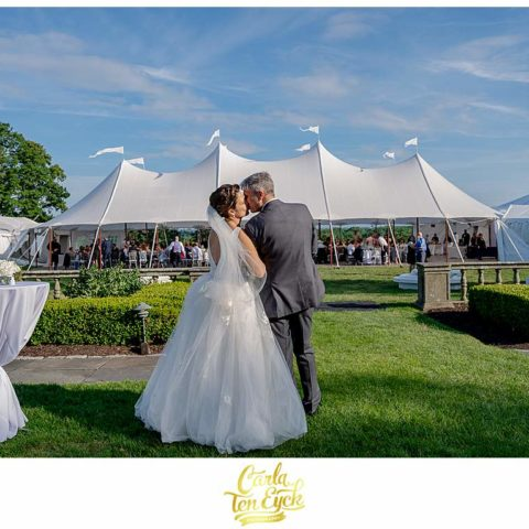 A couple kisses at their wedding at Fairfield University in Fairfield CT
