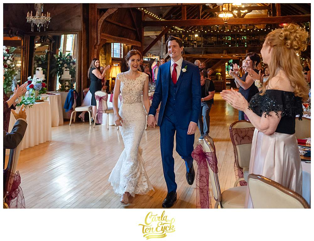 A bride and groom make their grand entrance at their Bill Miller's Castle wedding in Branford CT