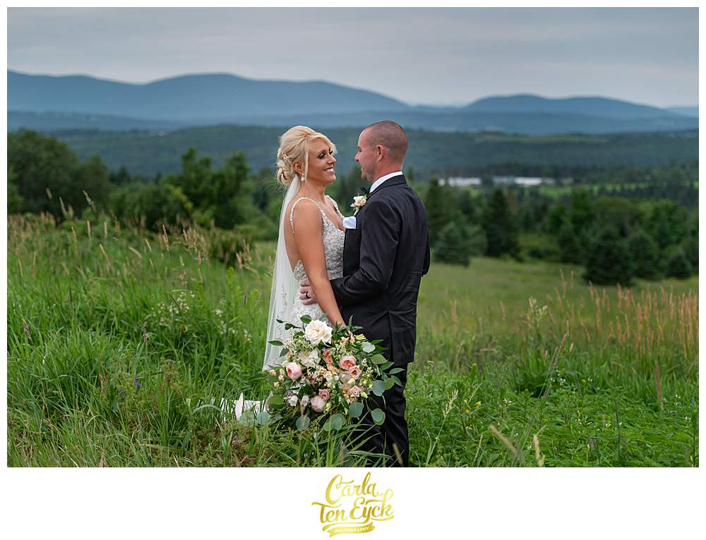 A bride and groom laugh during their New Hampshire wedding