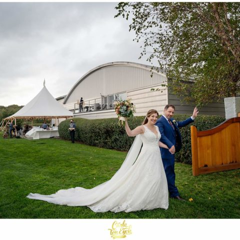A bride and groom wave hello at their Saltwater Farm Wedding in Stonington CT